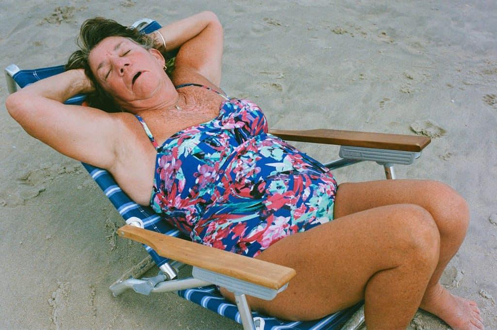 woman sleeping in a beach chair