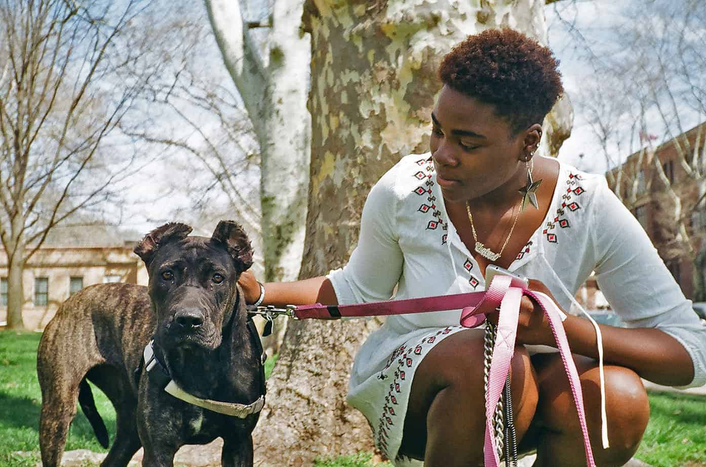 woman and pitbull in a park