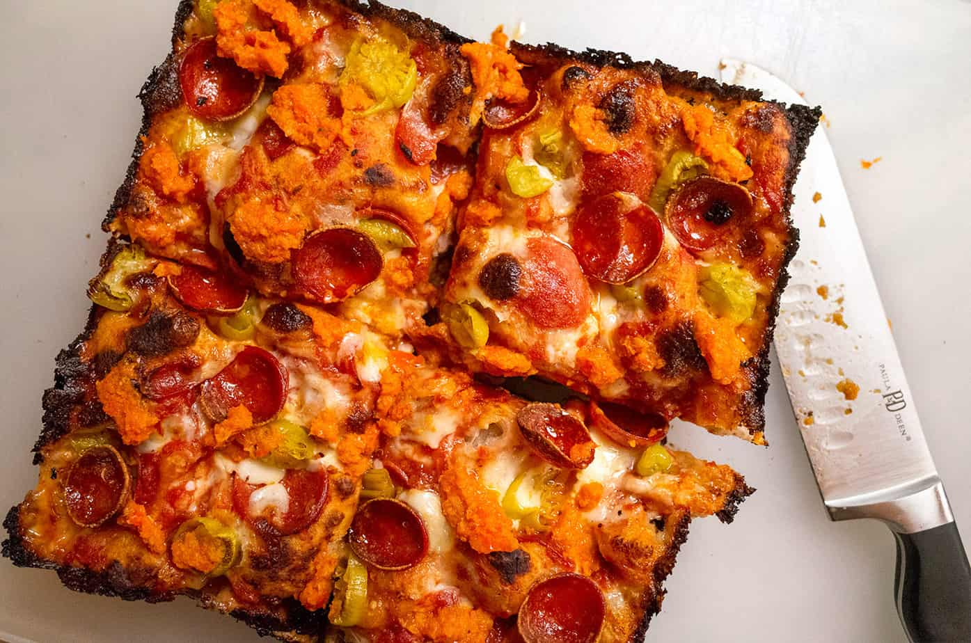 deep dish pizza with spicy pepperoni