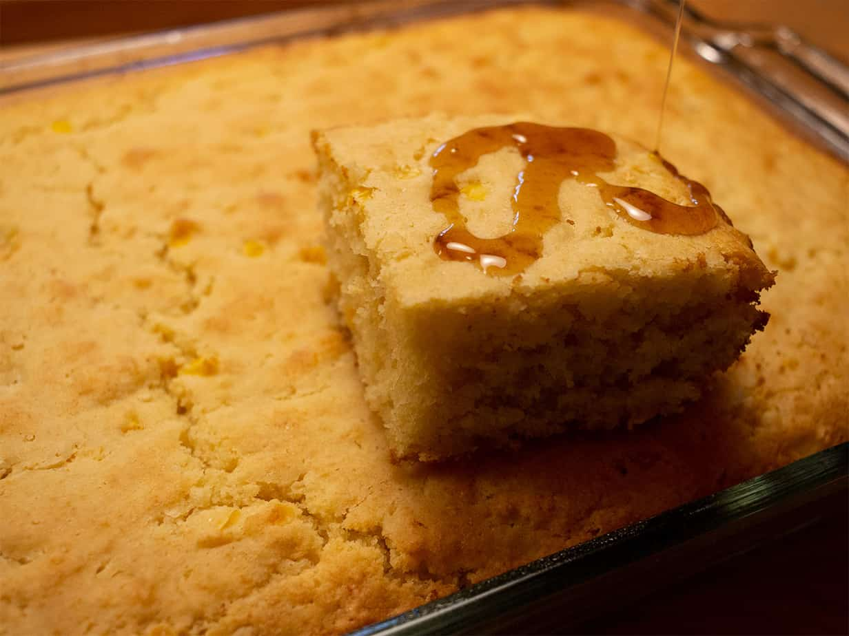 cornbread drizzled with maple syrup